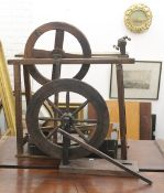 Two antique spinning wheels. The largest 75 cm long.