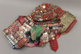 A Baluchi ceremonial overshirt and headpiece using older decoration items. The latter 27 cm long.