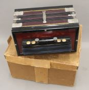 A Sterling Melodeon accordion. 25.5 cm wide.