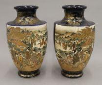 A pair of Japanese Satsuma vases. 25 cm high.