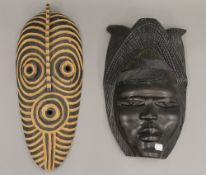 Two African carved wooden masks. The largest 45 cm high.