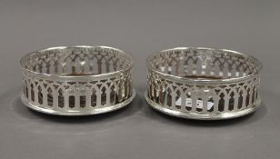 A pair of silver plated coasters. 12.5 cm diameter.