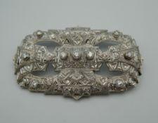 An Art Deco platinum diamond brooch. 7 cm wide. 21.7 grammes total weight.