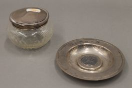 A silver coin set dish and a silver topped jar. The former 11.5 cm diameter. 3.3 troy ounces.