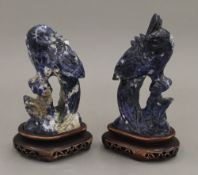 A pair of Chinese carved lapis carved birds, on stands. The largest 16 cm high overall.