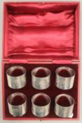 A cased set of six silver napkin rings. 7.9 troy ounces.