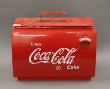 A Coca-Cola box. 43 cm wide.