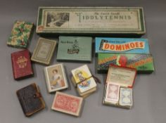 A quantity of vintage playing cards and games.