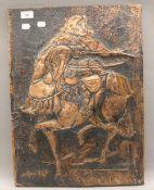 A copper relief panel of a Samurai Warrior on horseback. 41.5 x 56.5 cm.