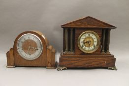A Victorian oak mantle clock and another. The former 31.5 cm high.