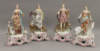Four porcelain figures representing the Seasons, possibly Meissen. The largest 27 cm high.