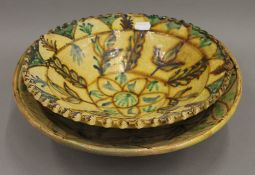 Two 19th century Continental glazed terracotta dishes. The largest 33.5 cm diameter.