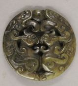 A jade roundel. 5 cm diameter.