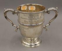 A silver trophy,