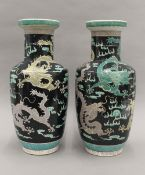 A pair of Chinese famille noir vases. 44 cm high.