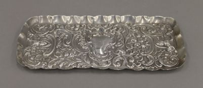 A silver tray, hallmarked 1892, maker's mark of William Comyns. 24 cm wide. 4.1 troy ounces.