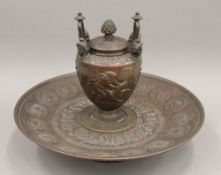 A Grand Tour bronze inkwell. 17 cm high.