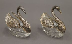 A pair of 925 silver mounted swan form salts and spoons. Each 6.5 cm high.