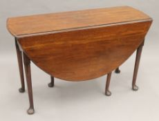 A 19th century mahogany drop leaf table. 120 cm long.