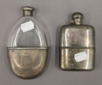 A silver mounted hip flask and a plated hip flask. The former 14.5 cm high.
