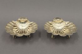 A pair of silver shell form salts. 11.5 cm wide. 10.9 troy ounces.