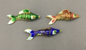 Three enamelled decorated fish. Each approximately 8.5 cm long.