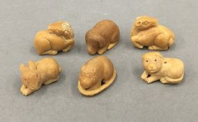 Six small carved bone animals. Each approximately 3 cm wide.