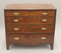 A George III mahogany chest of drawers. 91.5 cm wide.