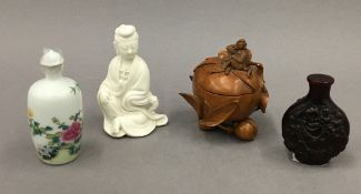A small Chinese porcelain blanc de chine figure of Guanyin,