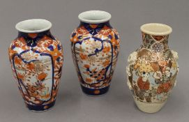 Two late 19th century Imari vases and a Satsuma vase. The latter 15 cm high.