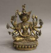 A gilt bronze multi-arm deity. 23 cm high.