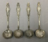 Four Chinese coin set spoons. 14 cm long.
