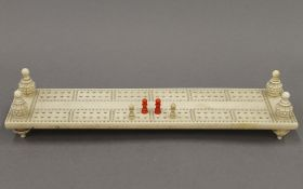 A 19th century carved ivory cribbage board. 27.5 cm long.
