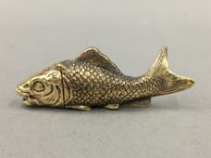 A brass vesta formed as a fish. 7.5 cm long.