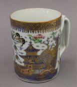 An 18th century Chinese porcelain tankard. 10.5 cm high.