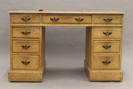 An Edwardian oak twin pedestal desk. 121 cm wide.