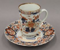 An 18th century Chinese tankard and an Imari plate. The former 12.5 cm high.