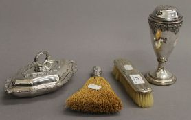 Two silver brushes, a plated castor and a small plated entree dish. The castor 16 cm high.