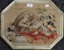 An early 19th century embroidered tapestry of a monkey, playing kittens and fruit,