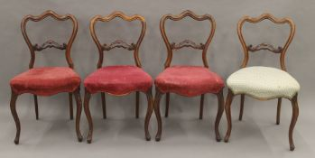 A set of four Victorian rosewood dining chairs