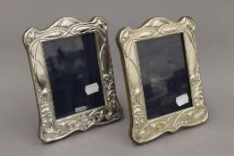 A pair of Art Nouveau style silver photograph frames. Each 20 cm high.