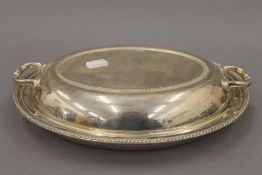 A silver entree dish. 28 cm wide. 31.2 troy ounces.