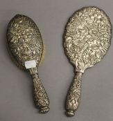 A Tiffany & Co sterling silver mirror and brush. The former 27 cm long. 16.