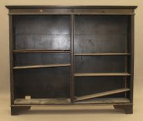 A 1920s oak open bookcase. 162 cm wide.