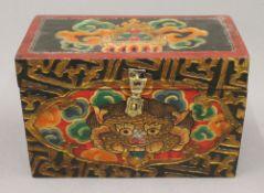 A hand painted Tibetan box. 23 cm wide.