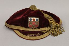 A 1934-35 velvet school cap.