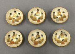 A set of six small Satsuma bowls. 3 cm diameter.
