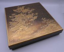 A Meiji Period Japanese lacquered artist's calligraphy box, the underside signed. 23.5 cm wide.