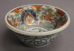 A Japanese Imari porcelain bowl of typical palette, square underglaze blue seal mark to base.
