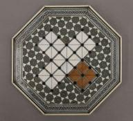 A 19th century Vizagapatam solitaire board. 20 cm wide.